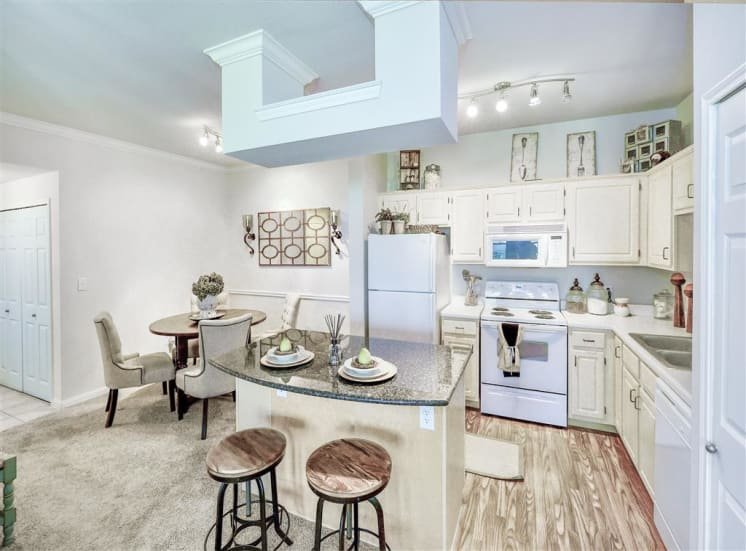 Dine-in island in kitchen of Cypress Lake at Stonebriar Apartments in Frisco, TX, For Rent. Now leasing 1, 2 and 3 bedroom apartments.