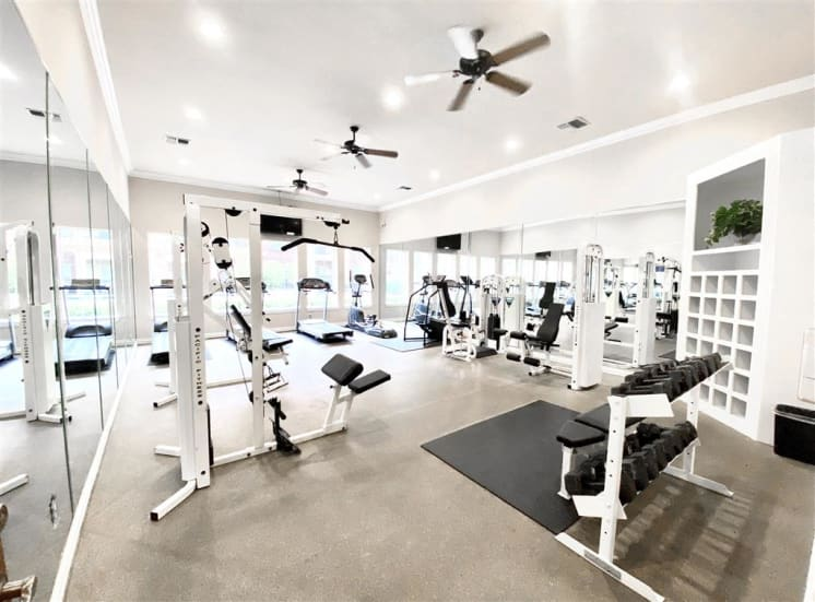 Huge fitness center with cardio and weight training. For Rent, Gates de Provence in North Dallas, TX.
