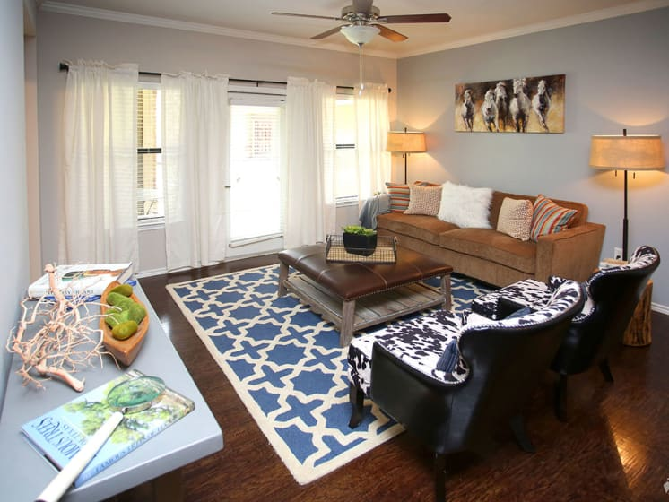 Spacious and Contemporary Living Room at Lost Spurs Ranch Apartments in Roanoke, Texas