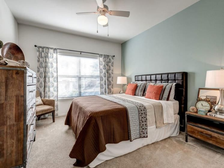 Modern Master Bedroom With Carpeted Flooring at Lost Spurs Ranch Apartments in Roanoke, Texas