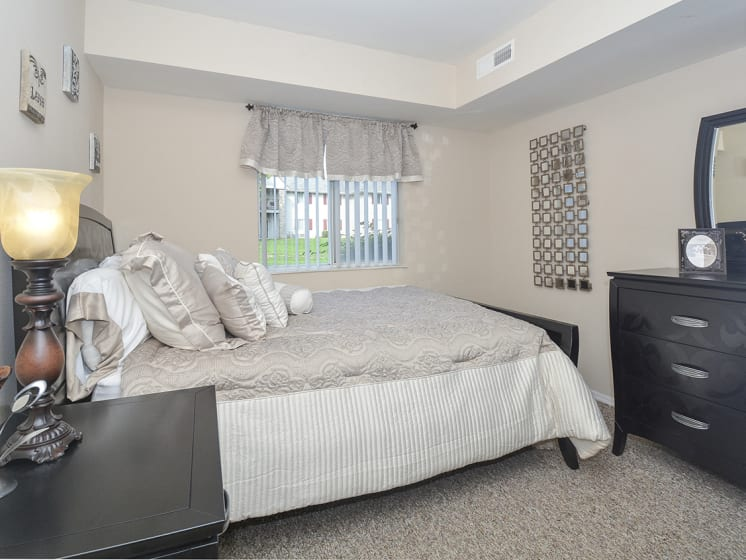 Bedroom with Large Double Window and White Trim