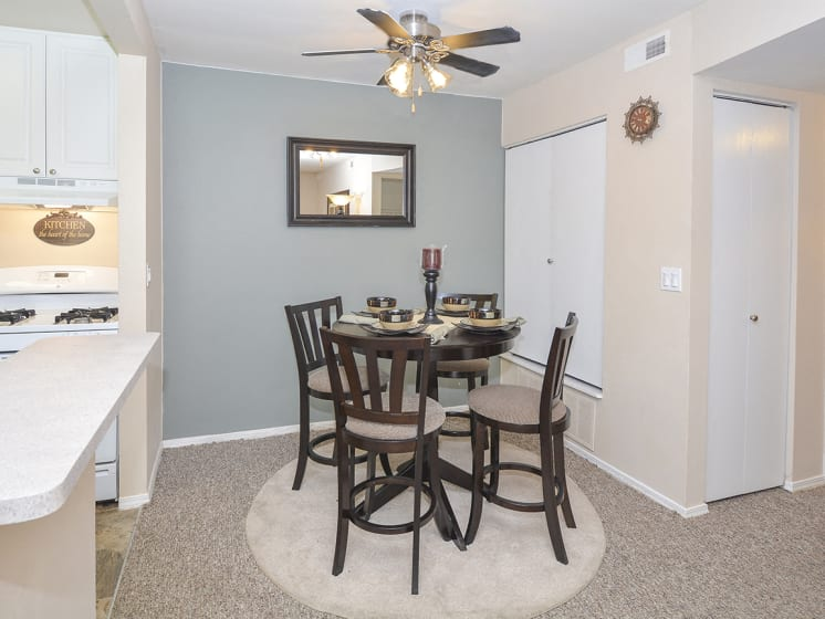 Carpeted Dining Room Area with Ceiling Fan and Light