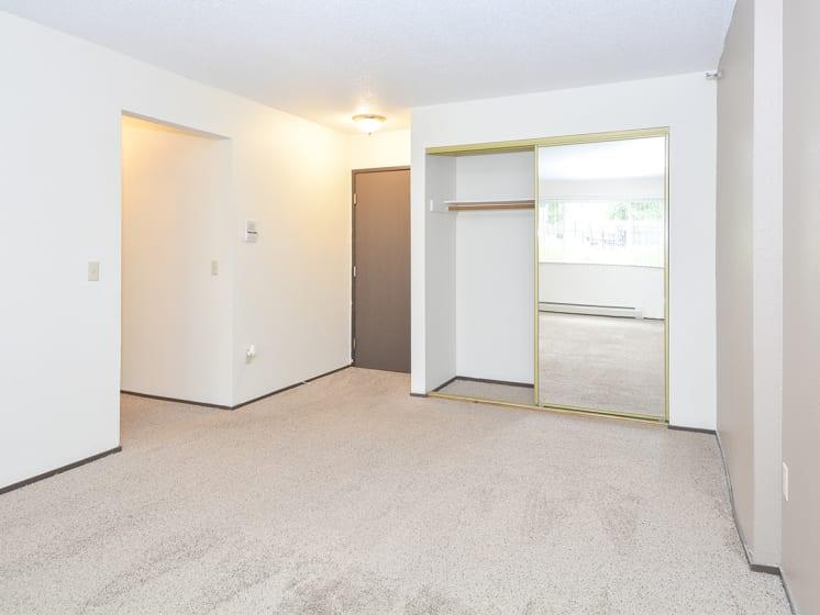 Spacious Bedroom with Mirrored Sliding Closet Doors