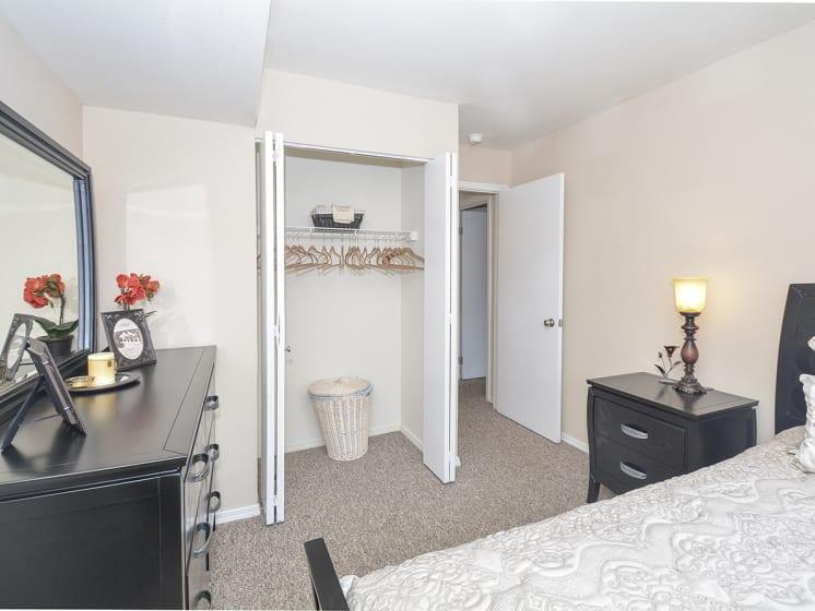 Carpeted Bedroom with Sliding Door Closet