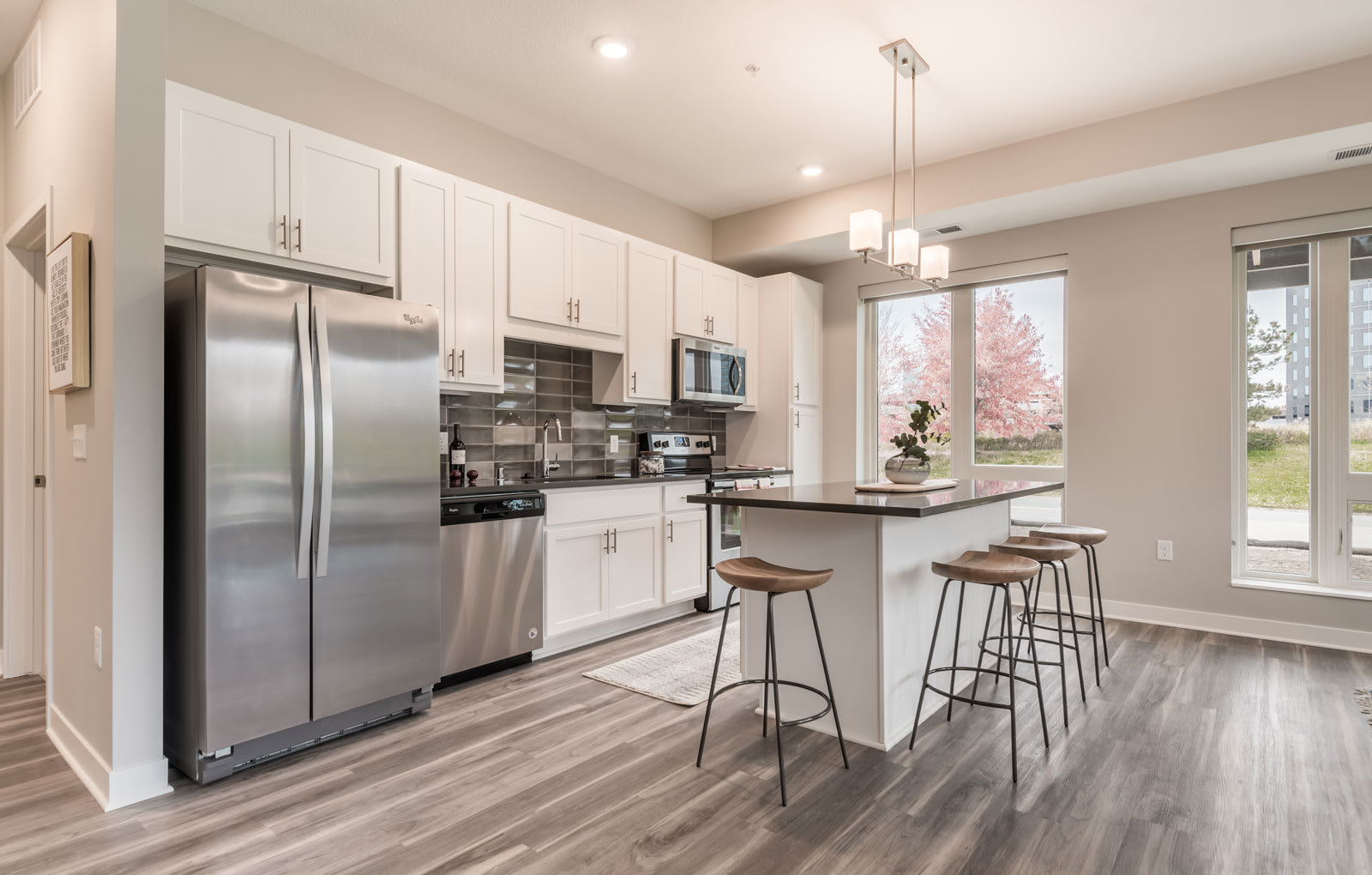 Spacious kitchens feature granite counter tops and spacious open floor plans
