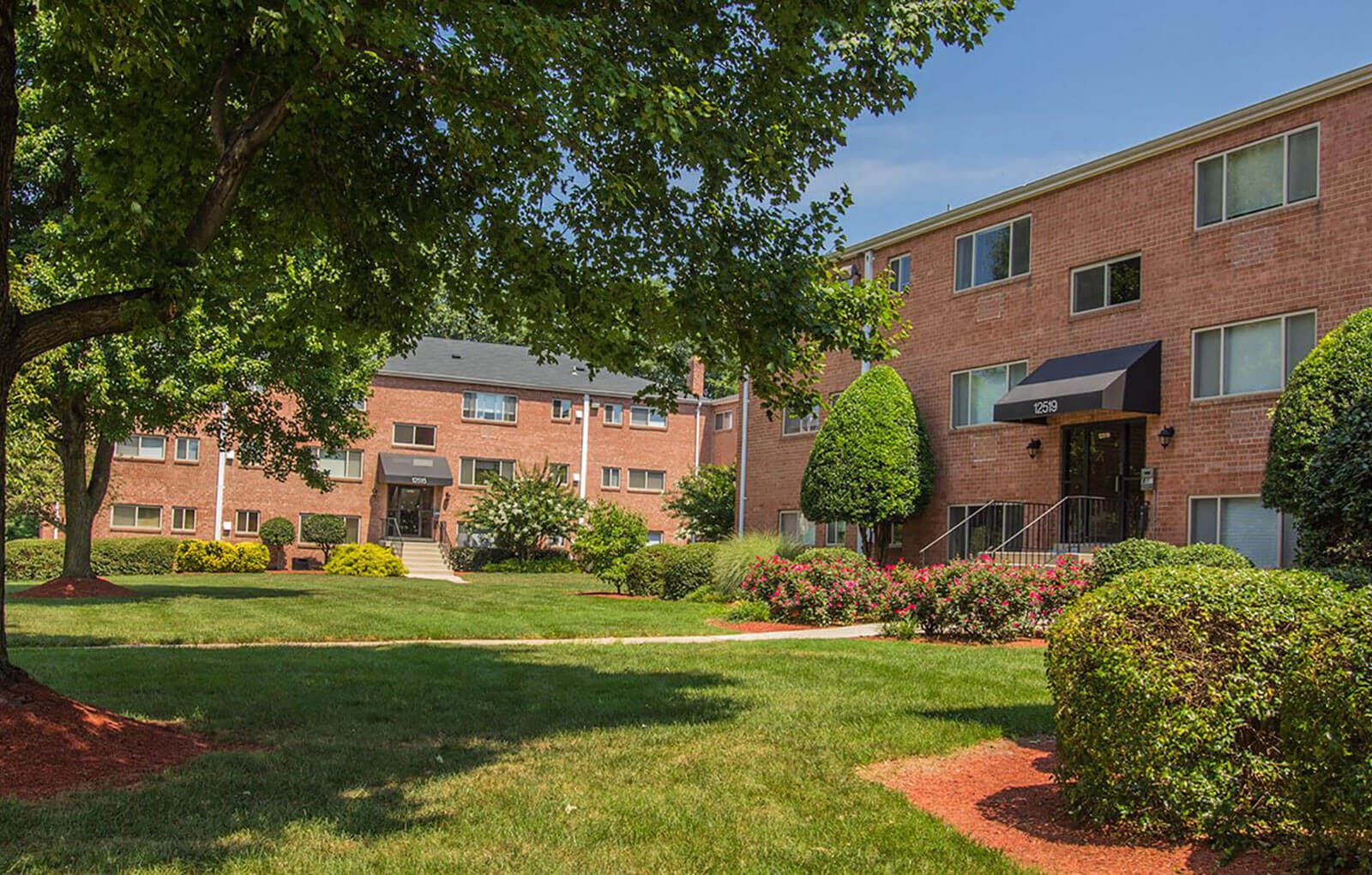 Lush Green Outdoor at Woodlee Terrace Apartments, Virginia