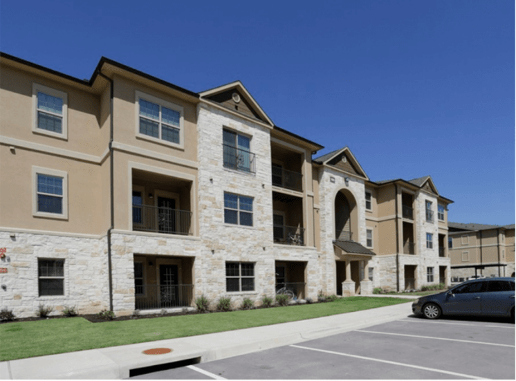 Front Entrance of Apartment Complex with Architectural Details at Arrington Ridge, Round Rock, 78665