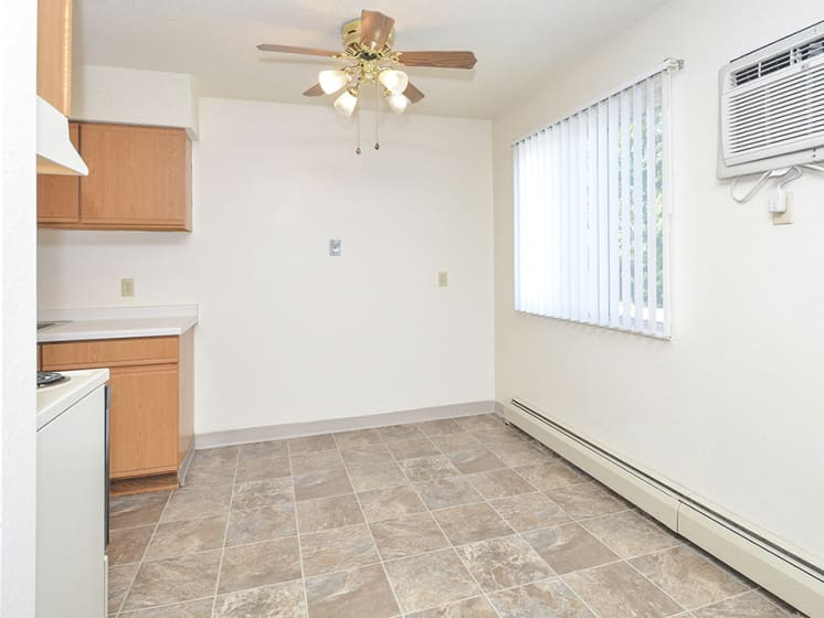 Dining Room with Tile Flooring and Large Double Window