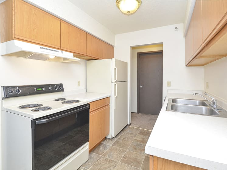 Galley Kitchen with White and Black Appliances