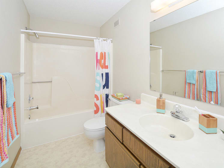 Full-Sized Bathroom with Tile Style Flooring and Large Vanity