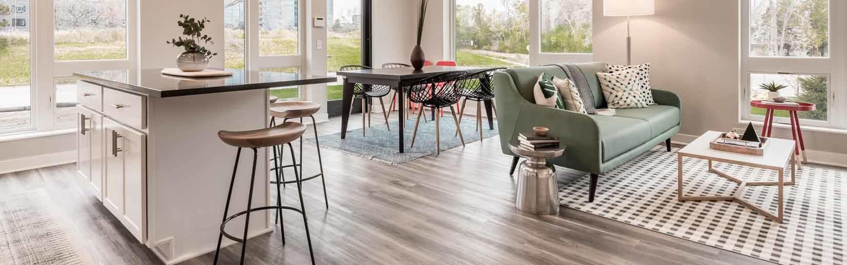 Interior photo of apartment with hardwood floors and quartz countertops