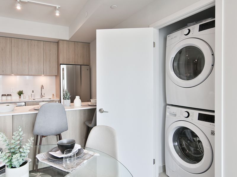 Stacked, front loading washer and dryer