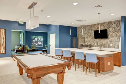 Clubhouse Common Area & Kitchen with Bar Seating, TV, and Billiards Table