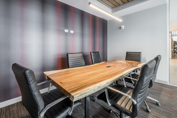 Confernence room with long table and office chairs