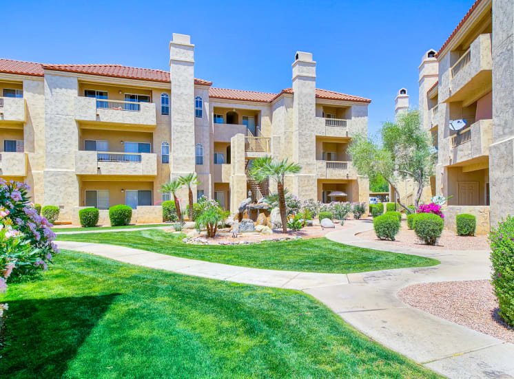 Rolling green grounds of Ventana Apartment Homes in Central Scottsdale, AZ, For Rent. Now leasing 1 and 2 bedroom apartments.