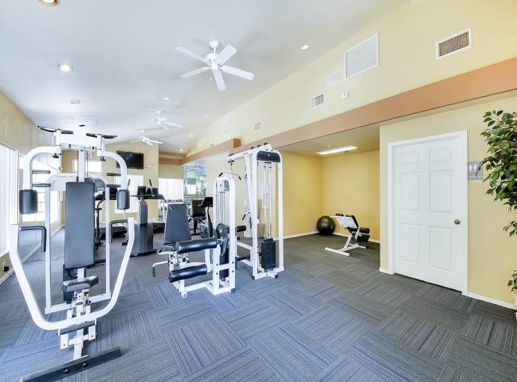 Weight training machines in gym of Ventana Apartment Homes in Central Scottsdale, AZ, For Rent. Now leasing 1 and 2 bedroom apartments.