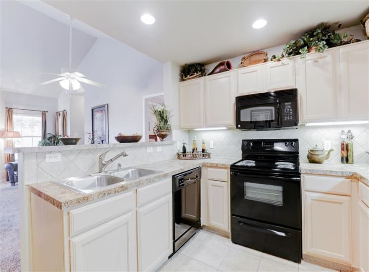 Microwave, ice maker, dishwasher and disposal in Saddle Brook Apartments in North Dallas, TX, For Rent. Now Leasing 1, 2 and 3 bedroom apartments.
