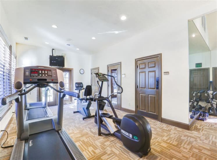 Elliptical machine in fitness center at Saddle Brook Apartments in North Dallas, TX, For Rent. Now Leasing 1, 2 or 3 bedroom apartments.