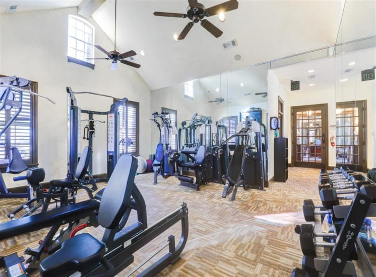 Cardio and weight training in fitness center at Saddle Brook Apartments in North Dallas, TX, For Rent. Now Leasing 1, 2 or 3  bedroom apartments.