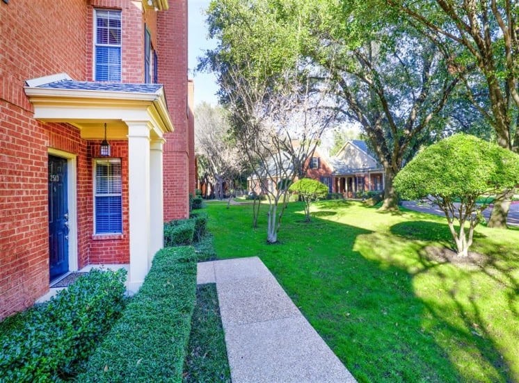 Green pathways of Saddle Brook Apartments in North Dallas, TX, For Rent. Now Leasing 1, 2 and 3 bedroom apartments.