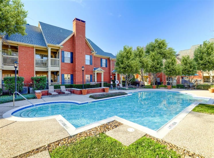 Sunny pool deck of Saddle Brook Apartments in North Dallas, TX, For Rent. Now Leasing 1 and 2 bedroom apartments.