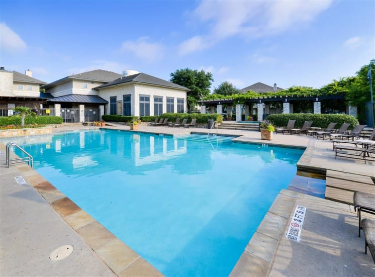 Resort pool and Clubhouse at Cypress Lake at Stonebriar Apartments in Frisco, TX, For Rent. Now leasing 1, 2 and 3 bedroom apartments.