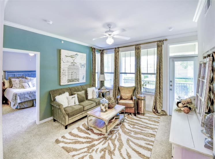 Spacious bright living room of Cypress Lake at Stonebriar Apartments in Frisco, TX, For Rent. Now leasing 1, 2 and 3 bedroom apartments.