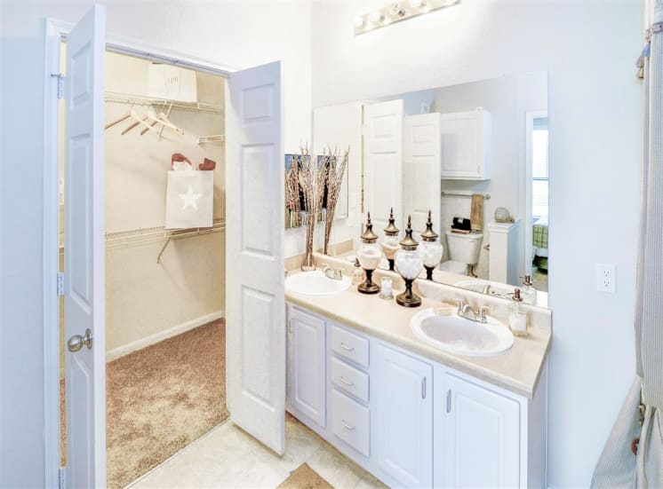 Mirrored bathroom vanity at Cypress Lake at Stonebriar Apartments in Frisco, TX, For Rent. Now leasing 1, 2 and 3 bedroom apartments.