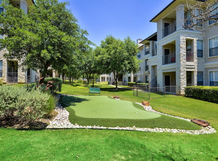 Lake views and putting green at Cypress Lake at Stonebriar Apartments in Frisco, TX, For Rent. Now leasing 1, 2 and 3 bedroom apartments.