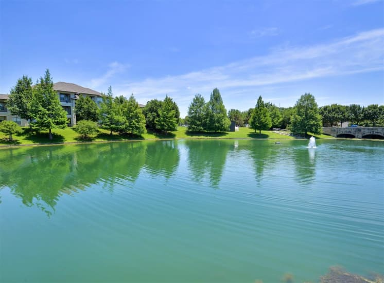Fishing deck and lake stocked with fish at Cypress Lake, Now leasing 1, 2 and 3 bedroom apartments.