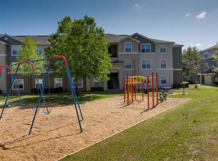Outdoor playground swing set, monkey bars, and slide