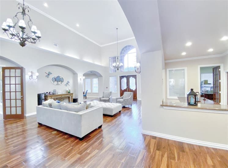 Front door and foyer with high ceilings. For Rent in North Dallas, TX 1, 2 and 3 bedroom apartments at Gates de Provence.