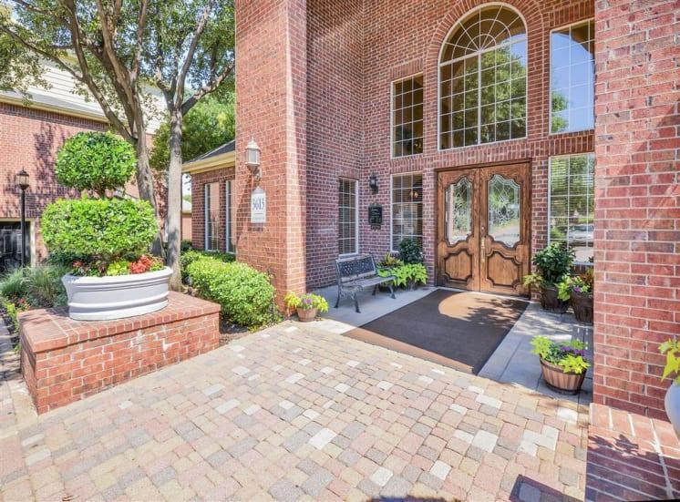 Front doors of Gates de Provence Apartment community in North Dallas, TX