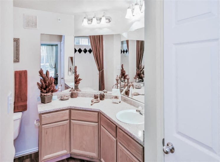 Double vanity with plenty of bathroom counter space and storage. Apartments for rent in North Dallas, TX.