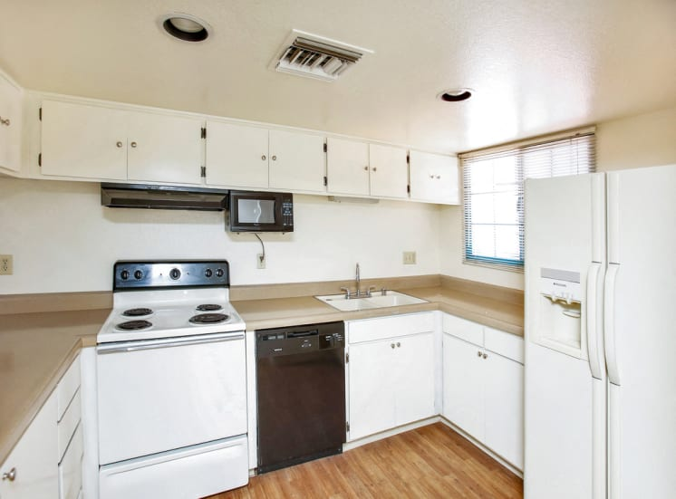 Wood floors and dishwashers at La Hacienda Apartments in Tuscan, AZ. Now leasing studio, 1 and 2 bedroom apartments.