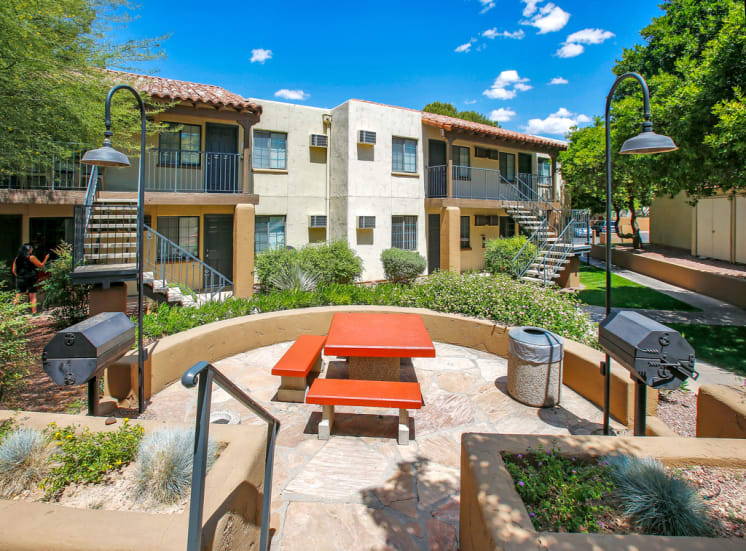 Outdoor picnic area with views of Tucson, AZ at La Hacienda, now leasing studio, 1 and 2 bedroom apartments.