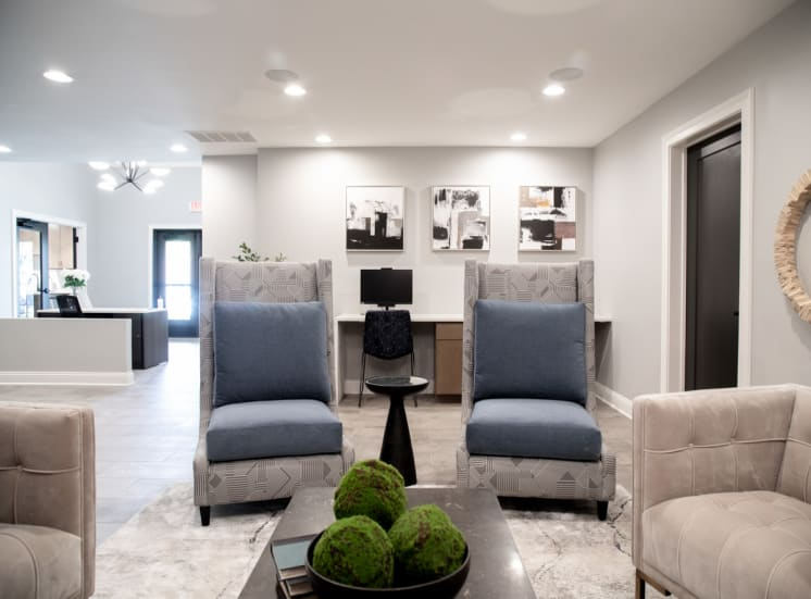 Resident seating in clubhouse at Governor Square Apartments, Carmel, IN