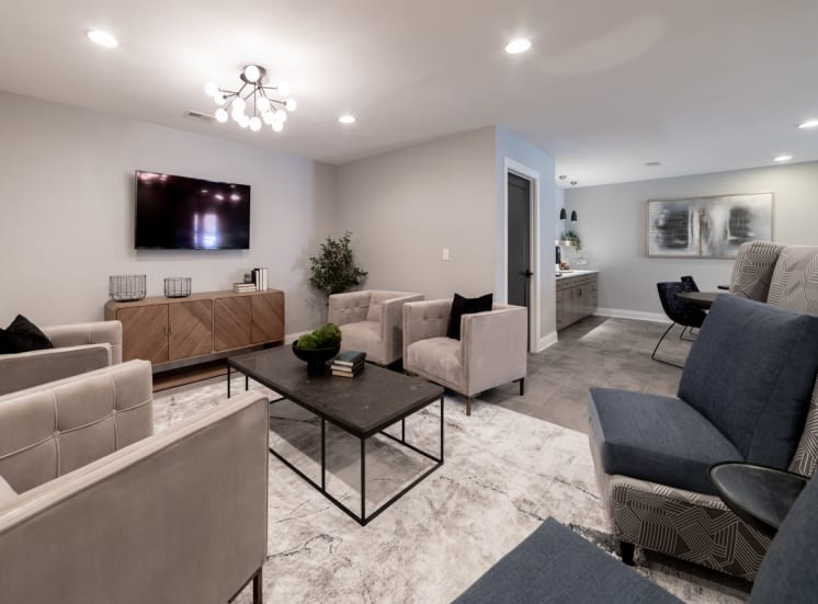 TV room with seating at Governor Square Apartments, Carmel, IN