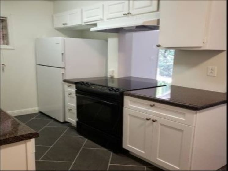 Renovated Kitchen - Range and Refrigerator View