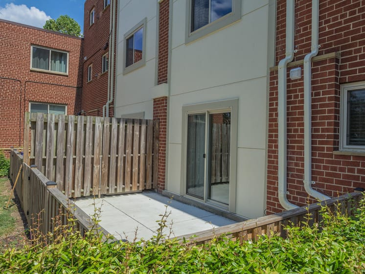 outdoor patio area connected with apartment unit