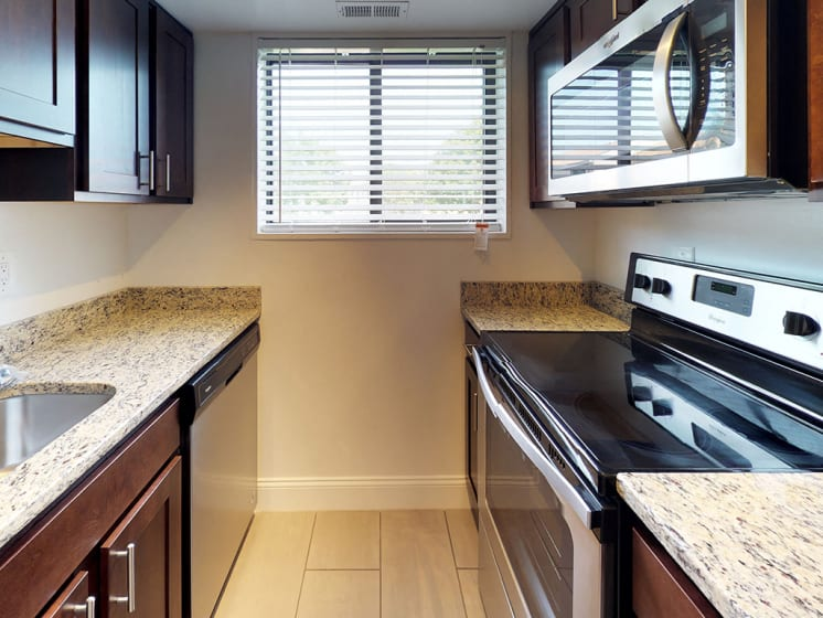 interior view of kitchen in apartment unit for bren mar