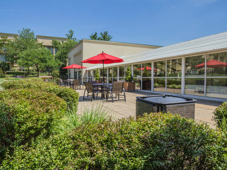 Outdoor Lounge With Umbrella Shades at Stuart Woods, Herndon, Virginia