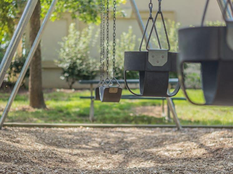 Swings At Playground at Stuart Woods, Herndon