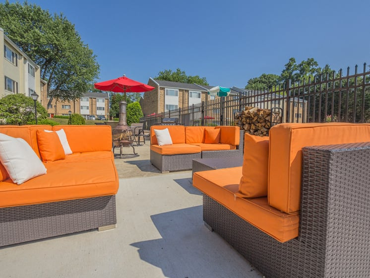 orange outdoor couches with sunshine