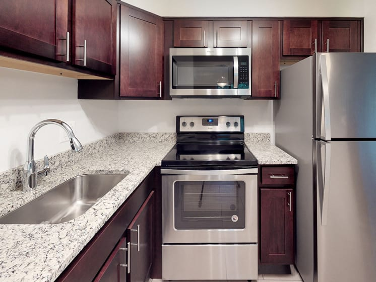 granite counters in kitchen space in apartment unit