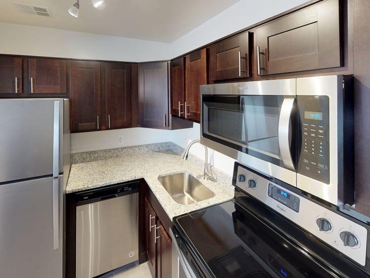 modern stainless steel appliances at Woodlee Terrace Apartments, Woodbridge, VA