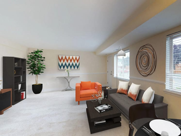 indoor seating area with contemporary sofa and chair at Gainsborough Court Apartments, Fairfax, VA, 22030