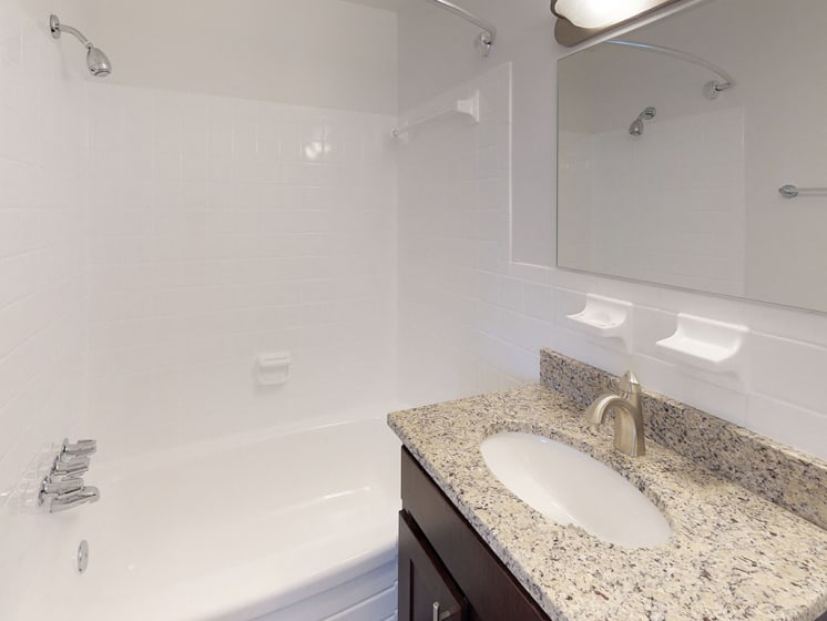 granite counters in bathroom with sink at Gainsborough Court Apartments, Virginia