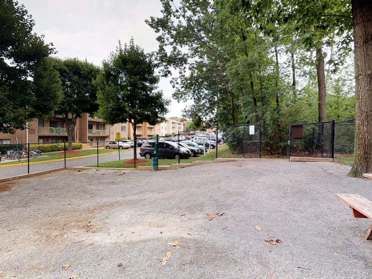 outdoor park area for residents with benches at Gainsborough Court Apartments, Fairfax, Virginia
