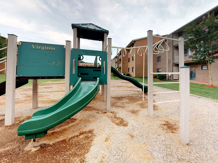 slide view with playground structure at Gainsborough Court Apartments, Virginia